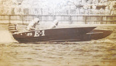 """<div class=""""source""""></div><div class=""""image-desc"""">Richmond Kennedy is shown here in the plywood race boat with a US E-1 painted on the side of the hull. That was the mark that he was number one in the 50 HP division, he said, noting that the high points champ didn't have to qualify for any of the races the year of their win – already guaranteed a spot to run. """"There are a lot of advantages to being number one,"""" Kennedy said with a laugh.</div><div class=""""buy-pic""""><a href=""""http://web2.lcni5.com/cgi-bin/c2newbuyphoto.cgi?pub=073&orig=1%2Bkennedy_6col_co_5ma.jpg"""" target=""""_new"""">Buy this photo</a></div>"""
