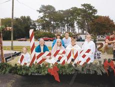 "<div class=""source"">BRENDA LOCKLEAR/Sumter County Times</div><div class=""image-desc"">Mary, Joseph, the baby Jesus, angels and shepherds were at the front of the float and giant red and white striped letters spelled out ""Jesus."" Shown, from left are: Chloe Perrin, Matthew Taylor, Haley Sheen, Tommy McGuire, Olivia Ragano, Brent Ragano and Zachary Taylor.</div><div class=""buy-pic""><a href=""http://web2.lcni5.com/cgi-bin/c2newbuyphoto.cgi?pub=073&orig=2%2Bpanasoffkee%2Bparade%2B2011_6col_co_3de.jpg"" target=""_new"">Buy this photo</a></div>"