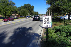 "<div class=""source"">LARRY CLIFTON/Sumter County Times</div><div class=""image-desc"">Newly installed temporary signs along eastbound Buenos Aires warn golf cart operators to merge with cars and trucks. Golf carts must merge and turn left into Buenos Aires Professional Plaza. There is no turning lane and carts must stop and yield to oncoming traffic on the four-lane boulevard before turning left into the plaza. 