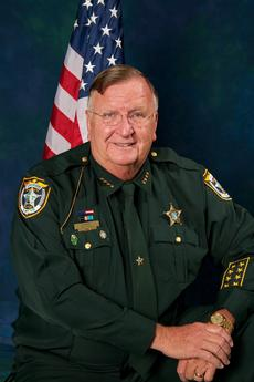 "<div class=""source""></div><div class=""image-desc"">Sheriff Bill Farmer</div><div class=""buy-pic""></div>"