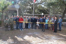 """<div class=""""source"""">Samantha Merritt</div><div class=""""image-desc"""">Members of the community gathered last week, at Dade Battlefield Historic Park for the ribbon cutting of the Scenic Sumter Heritage Byway. The crowd included officials, residents and members of the Scenic Sumter Heritage Byway, Inc. The byway obtained its official designation as the 24th Scenic Highway in Florida on May 2. </div><div class=""""buy-pic""""></div>"""
