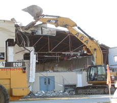 """<div class=""""source"""">Brenda Locklear</div><div class=""""image-desc"""">Demolition of the historic cow palace began last weekend with the destruction of the roof. The building will be replaced by a new facility.</div><div class=""""buy-pic""""><a href=""""/photo_select/13675"""">Buy this photo</a></div>"""
