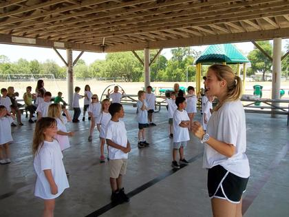 Local Girl Scout, Ashley Arnold, has been her troop for well over a decade and went after scouting's top honor - the Girl Scout Gold Award. She hosted a color run at Lake Panasoffkee Elementary School. She's shown here, leading students in exercise. To read the story, see the Aug. 17, 2017 edition of the Times.