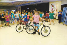 """<div class=""""source"""">LARRY CLIFTON/Sumter County Times</div><div class=""""image-desc"""">Timothy Leibold and Kaylan Flatt were awarded new bicycles for finishing as top ranking Accelerated Readers at Lake Panasoffkee Elementary School. The bicycles were donated by Principal Donna Wells and Mrs. Jennifer Prado, owner of the local McDonald's franchise.  </div><div class=""""buy-pic""""><a href=""""/photo_select/9638"""">Buy this photo</a></div>"""
