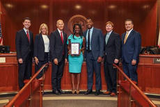 "<div class=""source""></div><div class=""image-desc"">Gassant shown accepting the award from Gov. Scott, along with other state officials. </div><div class=""buy-pic""><a href=""/photo_select/22179"">Buy this photo</a></div>"